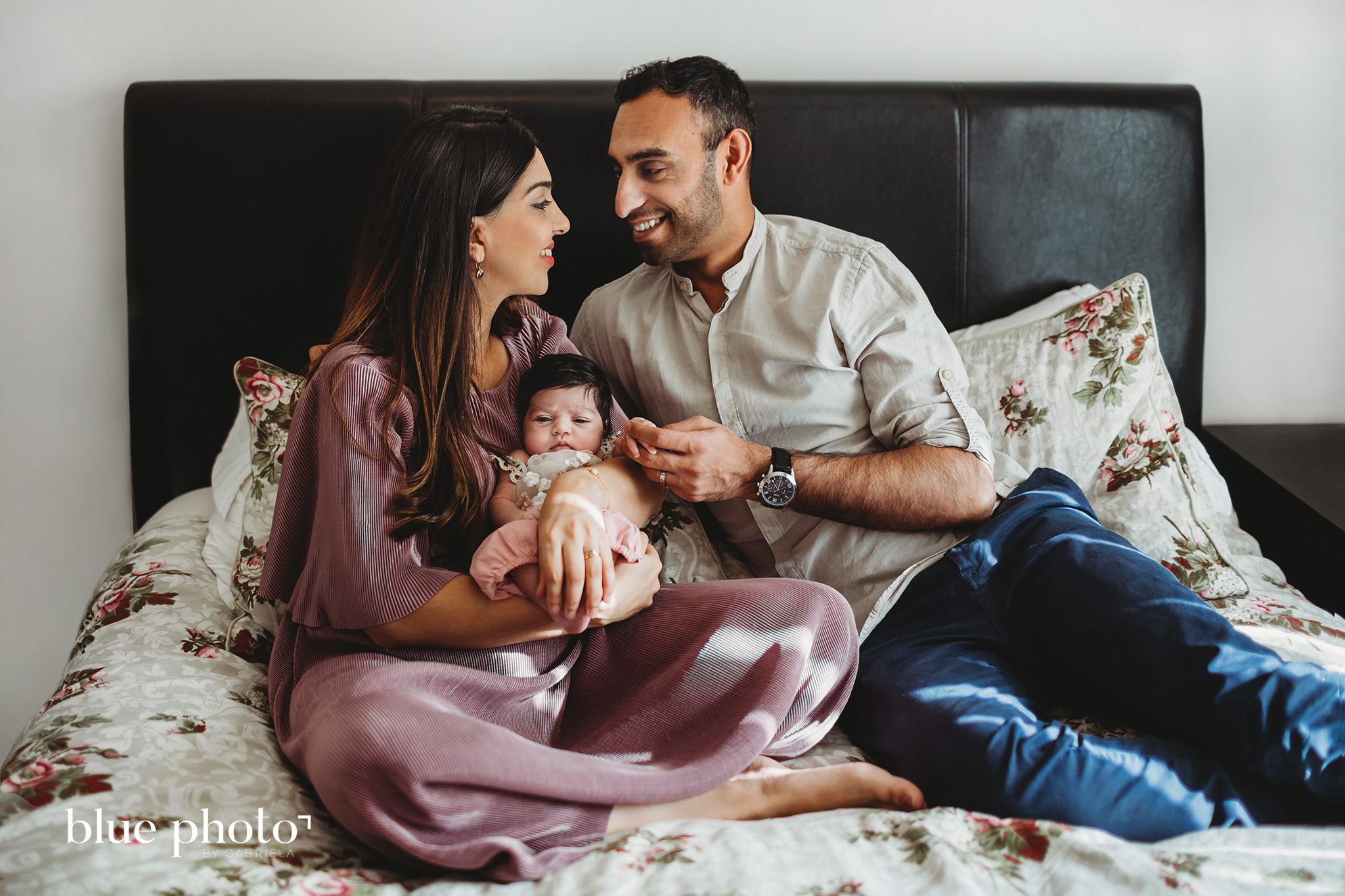 Sophia and her parents - lifestyle newborn photography in North London