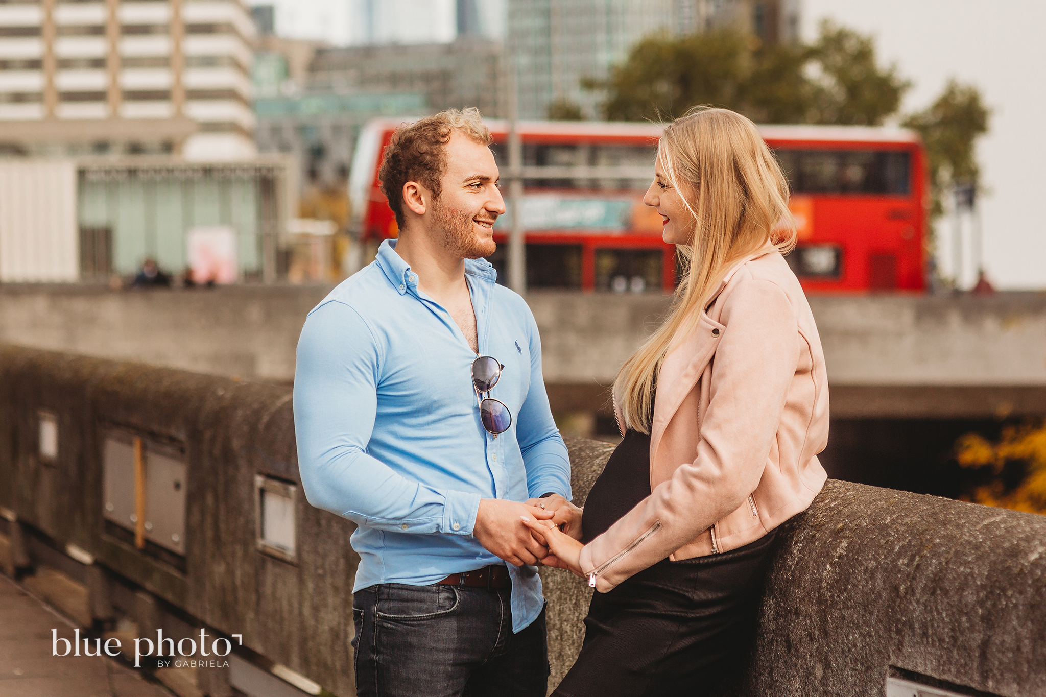 Angelika and Wojtek during their maternity session in South Bank, Central London. The couple is looking at each other and smiling.