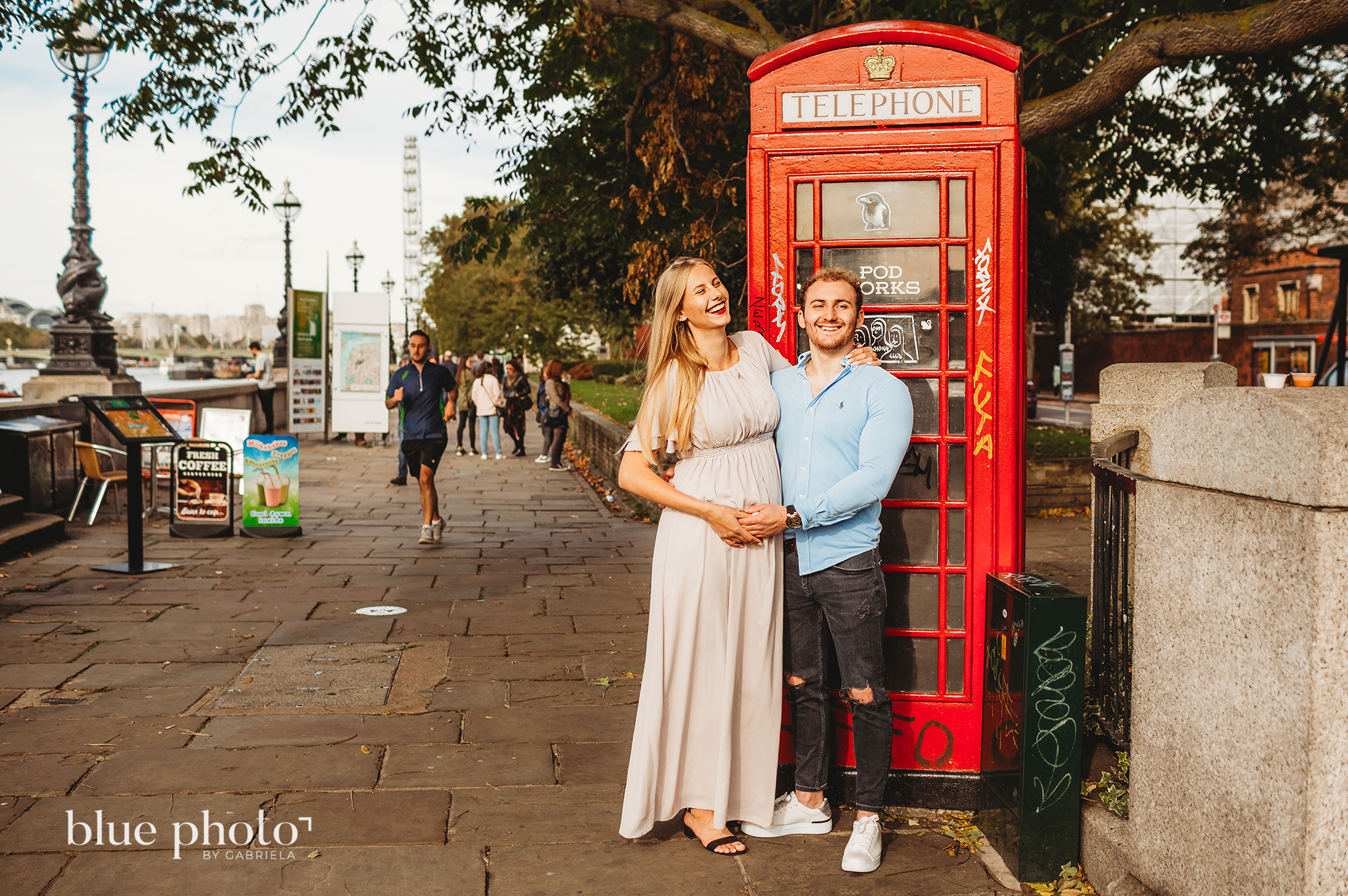 Angelika and Wojtek during their maternity session in South Bank, Central London. The couple is smiling.