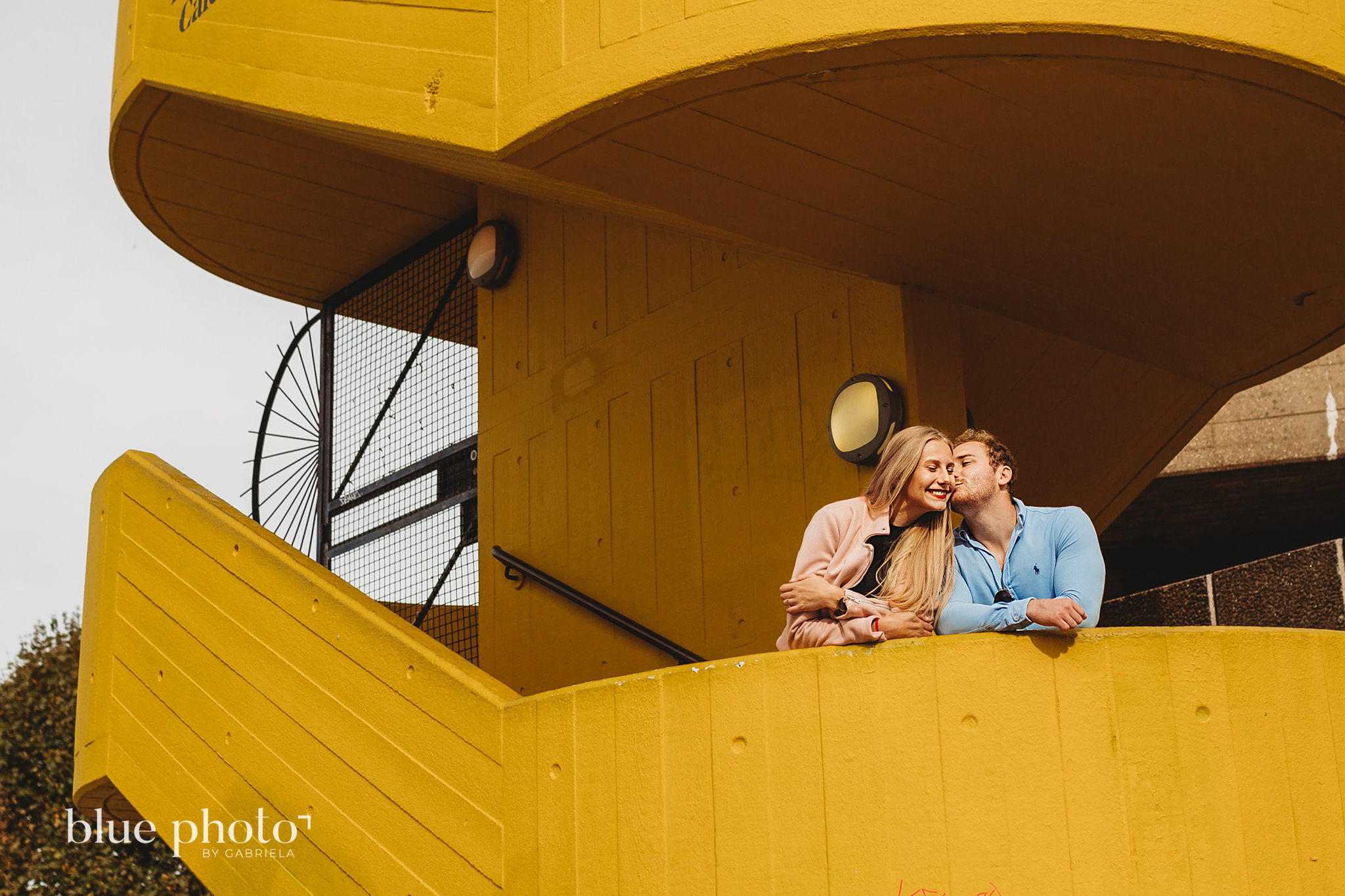 Angelika and Wojtek during their maternity session in South Bank, Central London. Man is kissing his partner.
