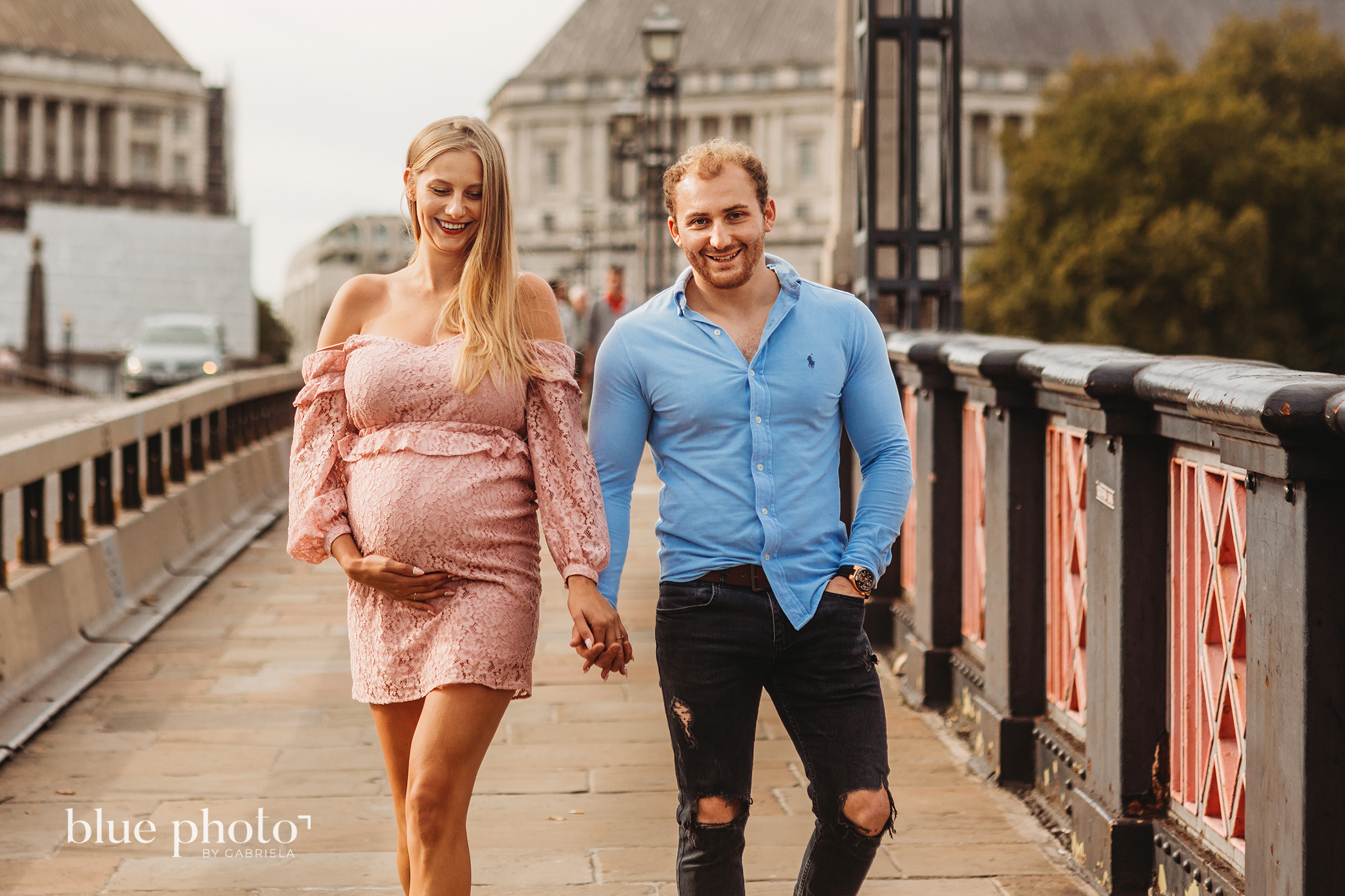Angelika and Wojtek during their maternity session in South Bank, Central London. The couple is walking and smiling.