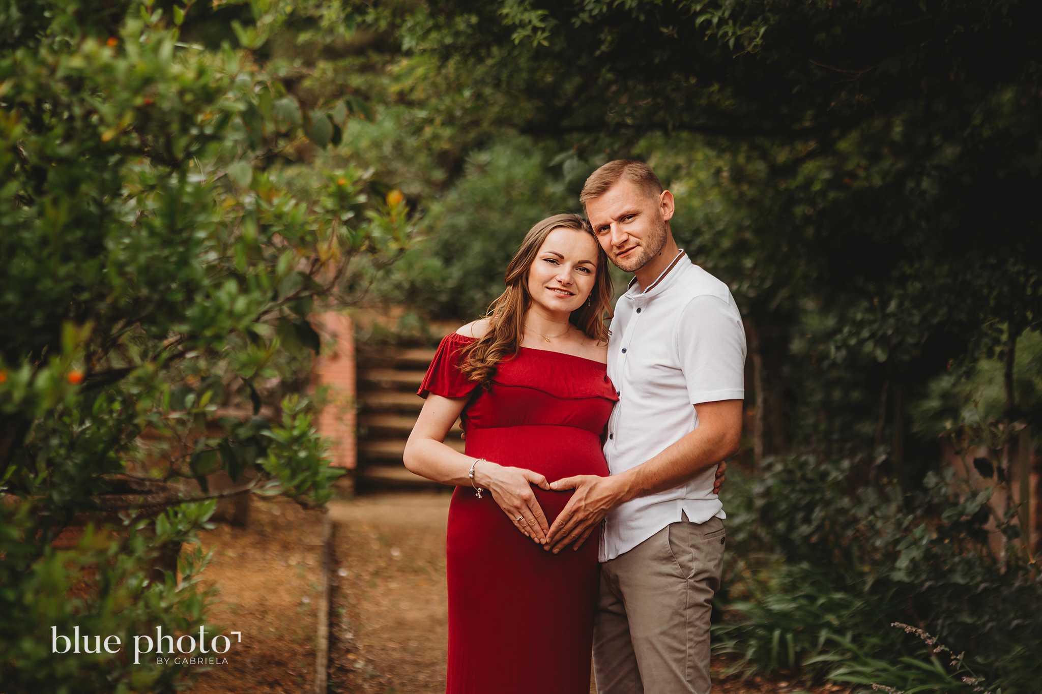 A couple is posing in The Hill Garden and Pergola, North London.
